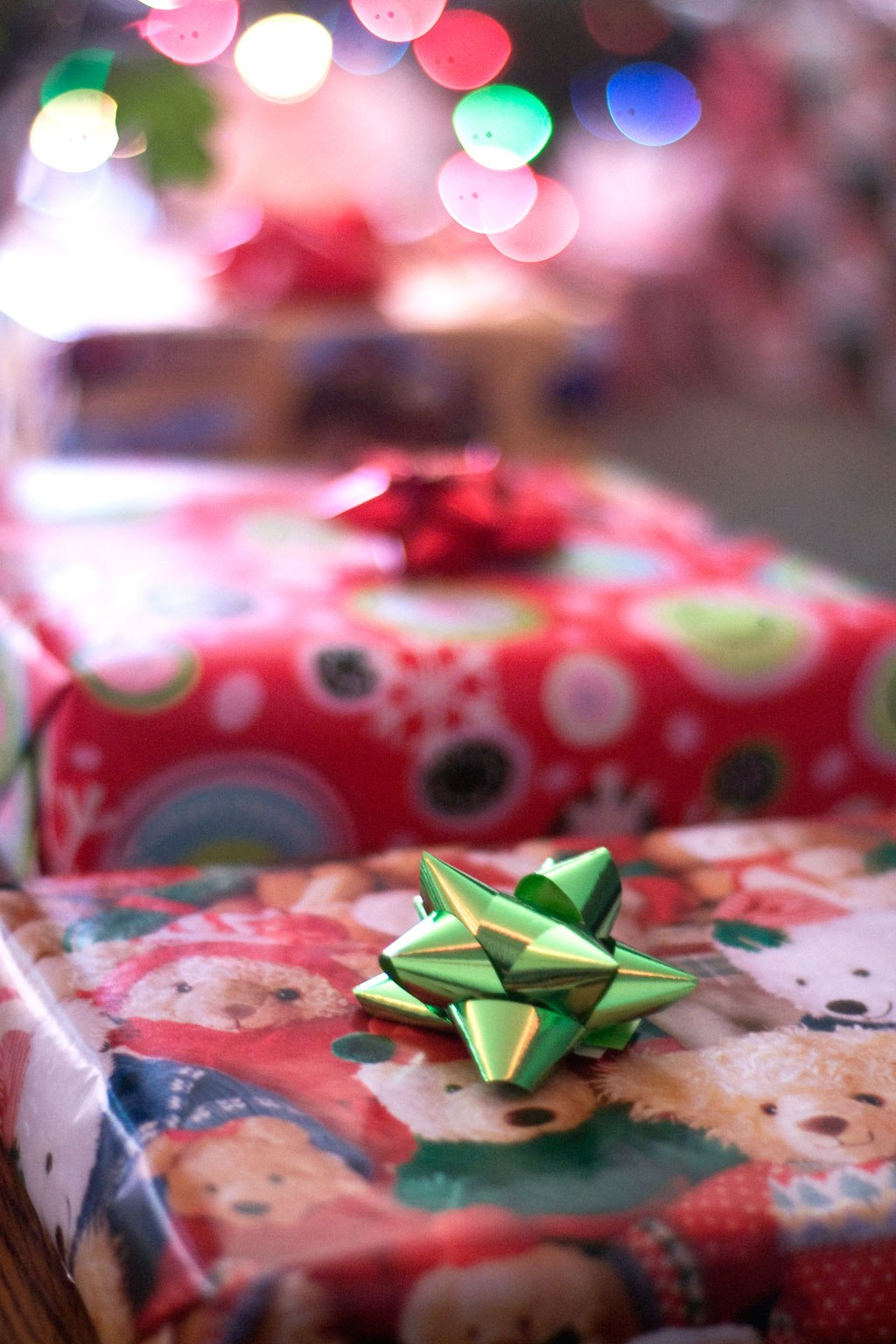 a photograph of three wrapped Christmas presents CC BY